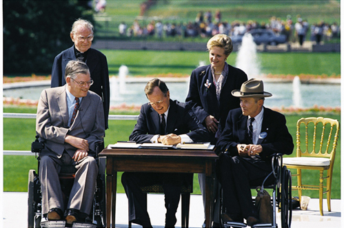 President George H.W. Bush signs the Americans with Disabilities Act on July 26, 1990