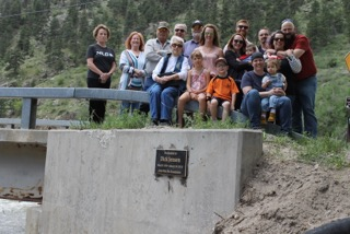 Members of the Jensen family dedicate a plaque