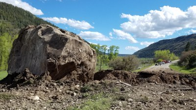 One of two boulders landed directly on the highway, the other (shown above) plowed through creating a 10- to 15- foot trench.