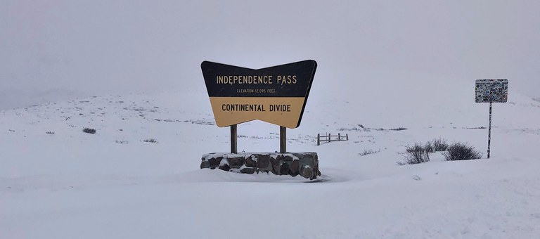 Snow and Independence Pass sign