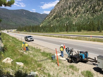 Fiber crew installing fiber cable.